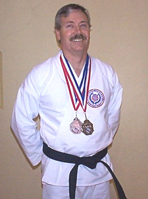 SENSEI TOM STORY WITH HIS MEDALS